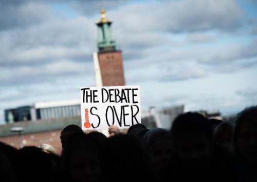 Des militants manifestent le 27 septembre 2013, en marge de la réunion du Groupe d'expert