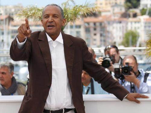 Abderrahmane Sissako poses during a photocall for the film Timbuktu