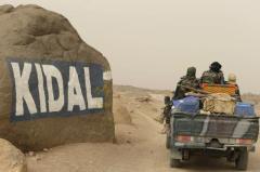 Des soldats maliens entrent dans Kidal, le 26 juin 2013